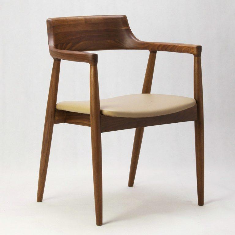 Modern designer chair with seat cushion